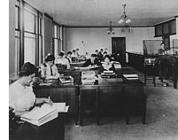Photo of employees at their desks